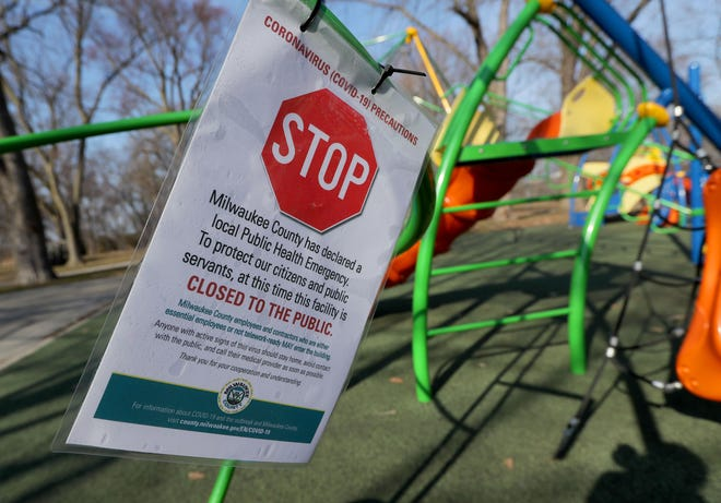 A sign tells people the park is closed at Kern Park on North Humboldt Boulevard in Milwaukee on Tuesday. Wisconsin Gov. Tony Evers'order to close nonessential businesses to slow the spread of the coronavirus pandemic includes playgrounds.