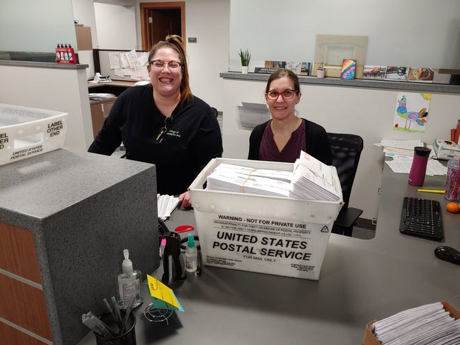 Whitefish Bay Deputy Clerk Caren Brustmann, left, and Administration Assistant Erin Granstrom are mailing 500 to 600 absentee ballots per day to village residents. Roughly 45% of Whitefish Bay voters had requested an absentee ballot as of March 24.