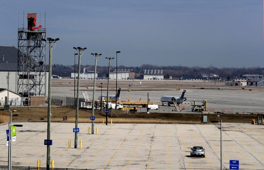 Parking lots at Mitchell International Airport are empty as fewer people are traveling in an effort to avoid the coronavirus.