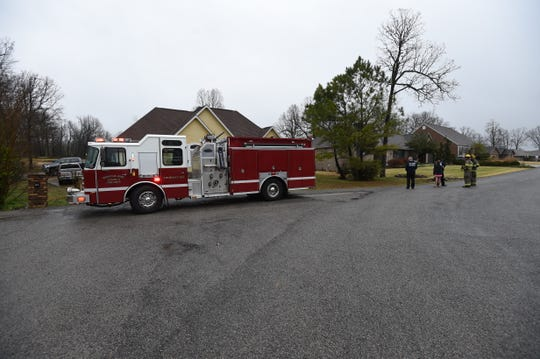 Mountain Home firefighters work at the scene of a lightning strike Monday morning in The Oaks subdivision located in Village Green East.