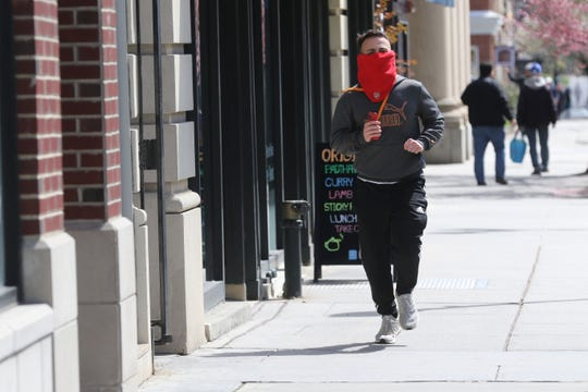 It's usually crowded on South St. during lunch hour but today there's room to run in Morristown, NJ on March 24, 2020 as New Jersey attempts to stop the effects Covid-19.