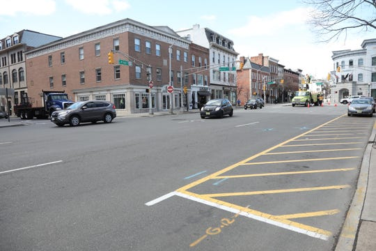 Very light traffic on West Park Pl. by the Green where large groups usually gather for lunch in Morristown, NJ on March 24, 2020 are empty at 1pm as New Jersey attempts to stop the effects Covid-19.