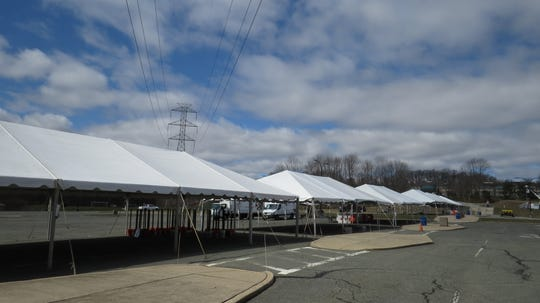 All quiet in Morris County March 24, 2020: Tents being erected for a coronavirus testing center in the parking lot of County College of Morris in Randolph.