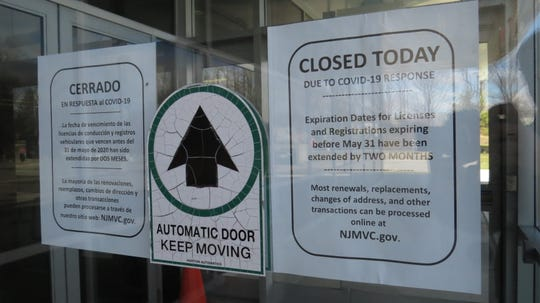 All quiet in Morris County March 24, 2020:  Signs on locked doors at the New Jersey Motor Vehicle Commission office and inspection station in Randolph.