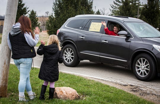 Students and family gathered roadside in neighborhoods near Royerton Elementary School to show their support for staff and administrators who formed a police-led parade Tuesday afternoon.  Delaware County schools closed March 16 to prevent the spread of coronavirus and will not reopen until at least April 6.