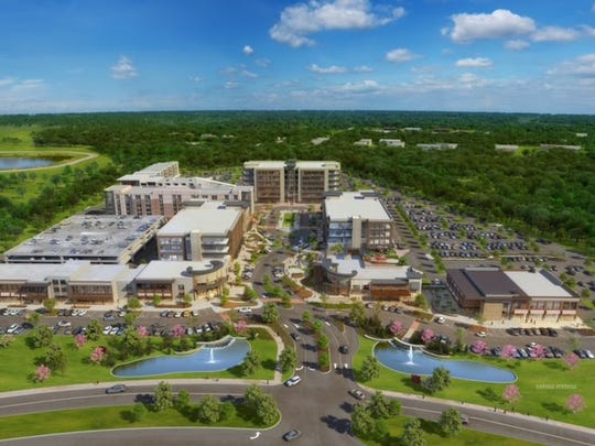 This Fountains at Gateway rendering shows long-term mixed-use development plans that include building spaces for offices, retail, residential and parking.