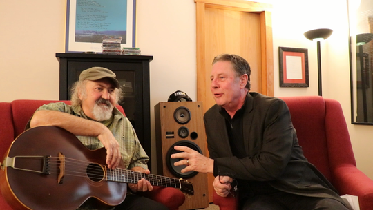 Kostas, left, talks to Bart Herbison about songwriting.