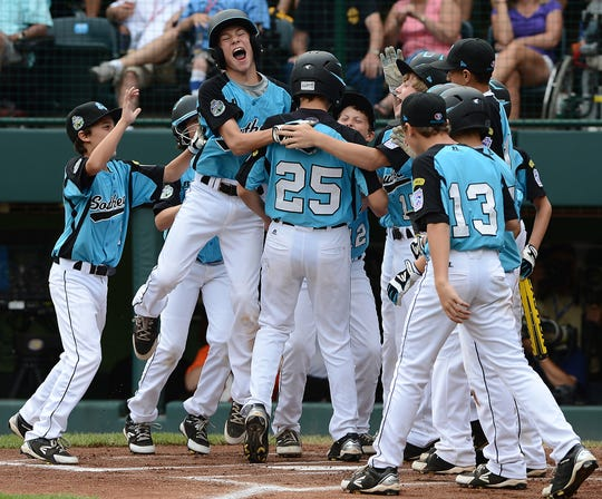 Brock Myers of Goodlettsville celebrates with his teammates after hitting a two-run homer against Petaluma, Calif., during the Little League World Series U.S. Championship game Aug. 25, 2012.