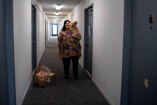 Bonnie Peters waves goodbye to FiftyForward Executive Director Sallie Hussey who delivered groceries at her home Tuesday, March 24, 2020, in Nashville, Tenn.