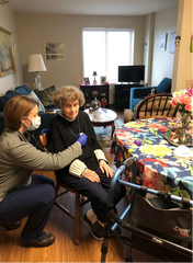 Vanderbilt University Medical Center nurse Kim Newton performs a routine at-home healthcare check for 91-year-old Norma Clemmons in her Tennessee home on Tuesday, March 24, 2020.