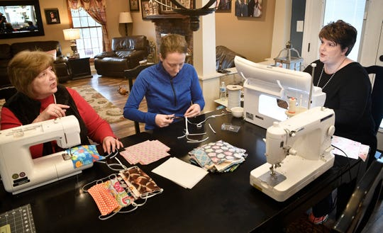 "Vickie Giuvens sews with her daughters Hope Dillard and Robin Moore who decided to make a few mask to help the cause. ""I thought maybe we would do a dozen"" Moore said. "" We did over 100 the first night. And we have requests for many more"" in Carthage, Tenn. Monday, March 23, 2020."