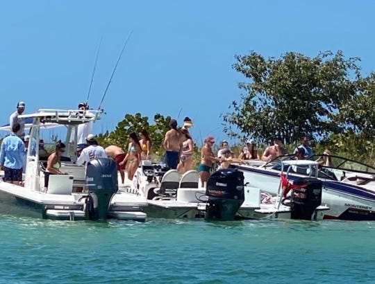 Boaters congregate near Keewaydin Island in Collier County on Sunday, March 22, 2020, around 2 p.m.