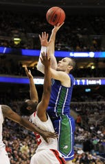 FGCU's Brett Comer scores against San Diego State on Sunday, March 24, 2013 at the Wells Fargo Center in Philadelphia in the Eagles' win to become the first 15 seed to reach the Sweet 16.