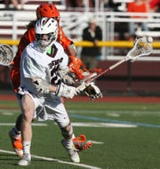 Jack Allard of Ridgewood has the ball knocked from his stick in a 2012 game against Mountain Lakes.