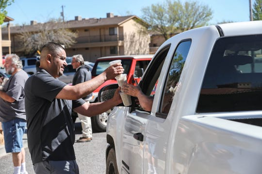 Employees and volunteers hand out rice after running out of beans and chile at The Game in Las Cruces on Tuesday, March 24, 2020.