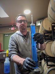 Head brewer and distiller Patrick Liessmann  of the Three Rivers Brewery demonstrates the distilling process that is used to produce hand sanitizer.