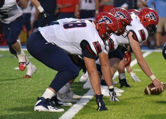 Livonia Franklin's Kyle Fugedi (58) plays both offensive tackle positions.