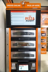Many customers to Daniel Wanshon's Canton Township Little Caesars utilize this Pizza Portal so that they can safely access their pies stored inside with a code.