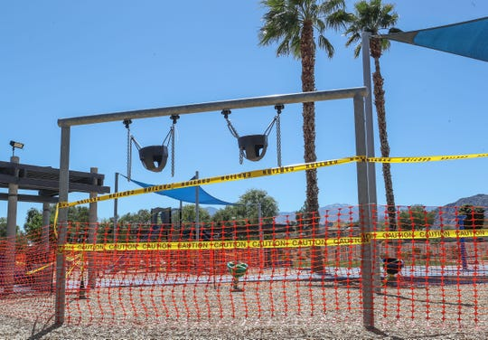 Swings are zip tied so they won't be used and the playground has been taped off at Adams Park in La Quinta, March 24, 2020.