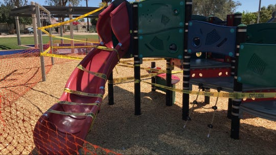 Yellow security tape prevents access to playground equipment at a La Quinta playground Tuesday, March 24, 2020. The city announced access to city parks is prohibited due to concerns about the coronavirus pandemic.