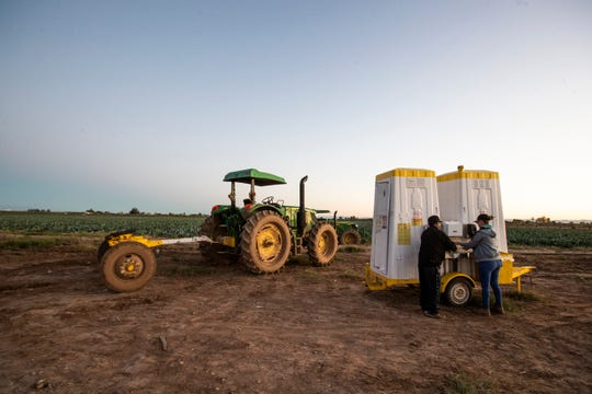 Farmers wash their hands as they prepare to start their day harvesting romanesco cauliflower in Imperial Valley. Of a group of 29 farmers 22 had crossed from Mexico in the early hours of the morning to attend to the harvest. Landowners are rushing to harvest their product as they fear a COVID-19 contingency could affect their harvest.