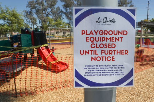 A sign on the playground equipment at Adams Park in La Quinta tells the public it has been closed by the City of La Quinta in response to the coronarvirus, March 24, 2020.