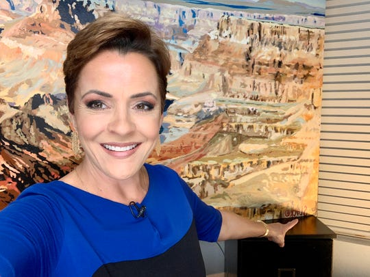 Fox 10 anchor Kari Lake with the painting by Phoenix artist Randy Slack she commissioned. She's using it as a background while broadcasting from home during the coronavirus pandemic.