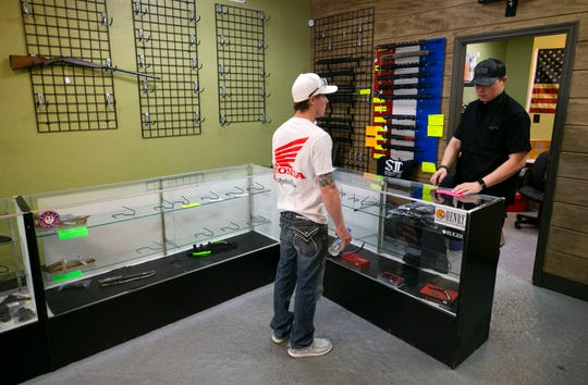 Shawn Ray, owner of S2 Armament LLC, tells a customer that nearly all inventory of firearms and ammo are sold out at Patriot Nation Firearms and Accessories in Phoenix.