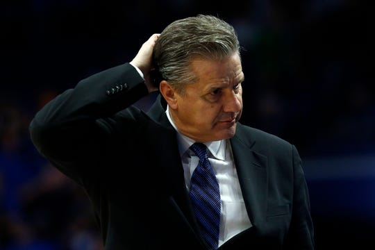Kentucky coach John Calipari scratches his head late in the second half of the team's NCAA college basketball game against Tennessee, Tuesday, March 3, 2020, in Lexington, Ky. Tennessee won 81-73. (AP Photo/James Crisp).