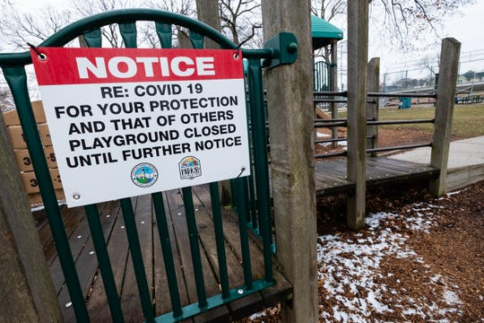 A sign telling visitors that the playground is closed hangs on the play structure at Pine Grove Park Tuesday, March 24, 2020, in Port Huron. Based on recommendations from state and local health officials, it was ordered that all playground equipment in the city be closed until further notice to help prevent the spread of coronavirus, effective Monday.