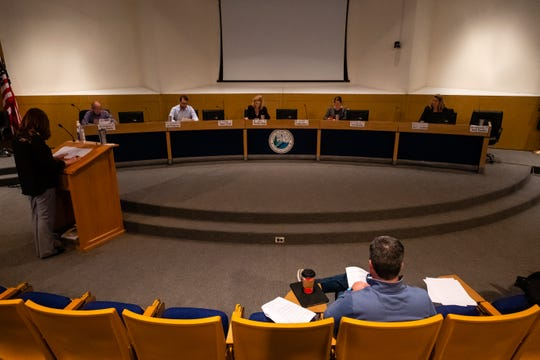 Port Huron City Manager James Freed, forward right, listens during a City Council meeting Monday, March 23, 2020, at the Municipal Office Center in Port Huron. Councilmembers were seated farther apart to maintain a safe distance to help prevent the spread of coronavirus.