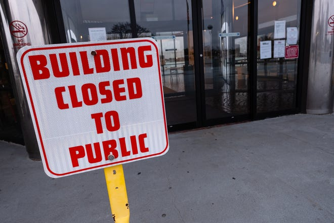 A sign outside the Municipal Office Center in Port Huron in March 2020.