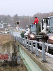 Volunteers stock trout at a Dutchess County fishing spot last week.