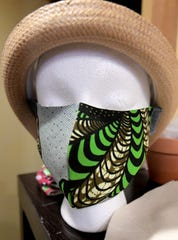A mask made by Gusa by Victoria owner Victoria Kageni-Woodard and her children is on display at her York City shop Tuesday, March 24, 2020. The masks are being distributed locally and abroad due to a shortage amid the Covid-19 virus pandemic. She said she expects to make 100 per day. Bill Kalina photo