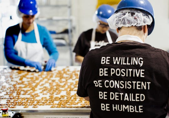 "Wolfgang Confectioners general production employees work at the Loganville facility in a file photo. According to a facebook post, Friday, March 20, 2020, the company is seeking new workers ""due to the increased demand and need to restock store shelves."" Application details are at: https://wolfgangco.easyapply.co/. submitted photo"