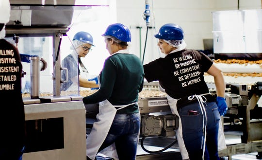 "Wolfgang Confectioners general production employees work at the Loganville facility in a file photo. According to a Facebook post, Monday, March 20, 2020, the company is seeking new workers ""due to the increased demand and need to restock store shelves."" Application details are at: https://wolfgangco.easyapply.co/. submitted photo"