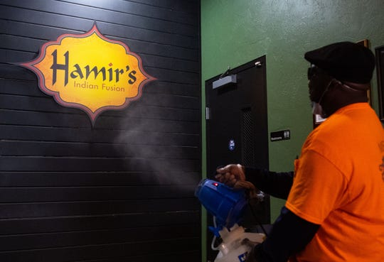 Every inch of Hamir's Indian Fusion is being sprayed by the fogger.