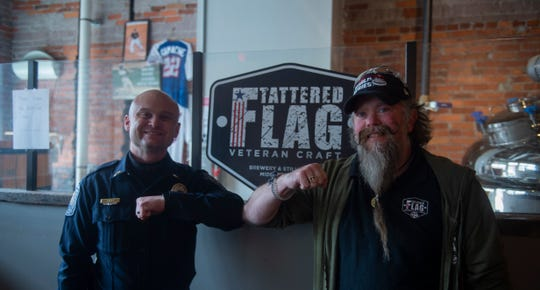 LT. Braxton Ditty of Newberry Township (left) stands with Tattered Flag brewmaster Daniel Kulick (right). The team at Tattered Flag Brewery and Still Works in Middletown has transitioned to make hand sanitizer for local EMS, first responders and hospital crews.