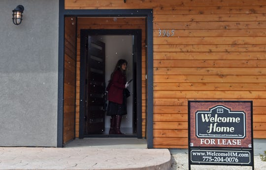 Realtor Erika Lamb stands at the doorway of a home she had been showing to protential buyers in Reno on March 24, 2020.