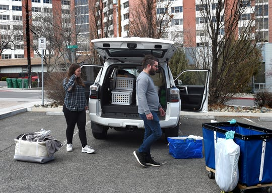 UNR freshman Allison Dean, left, moves out of her UNR dorm with some help from her brother Justin Dean on Monday March 23, 2020. She is going back home to Las Vegas.