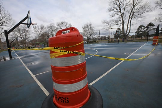 The popular Tony Boler Basketball Courts at Cobbs Hill Park are closed, surrounded by 'Caution Do Not Enter' tape, in Rochester Tuesday, March 24, 2020.  Playgrounds and courts around Monroe County are closed in an effort to keep people safe during the coronavirus pandemic.