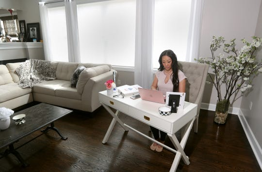 Local realtor Soo Kim set up an office area in the  living room of her Webster home.