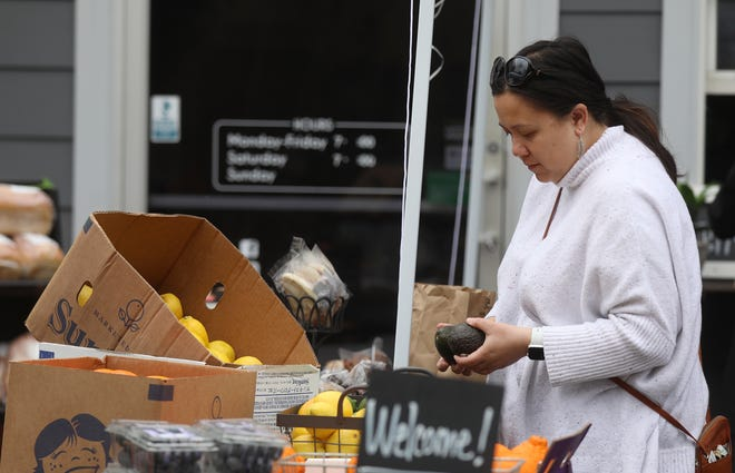 Tree Town Cafe started offering other products by other small businesses that have been struggling with the shutdown to stop the spread of COVID-19.  Lauren Lee of Penfield shops for some produce on March 24, 2020.