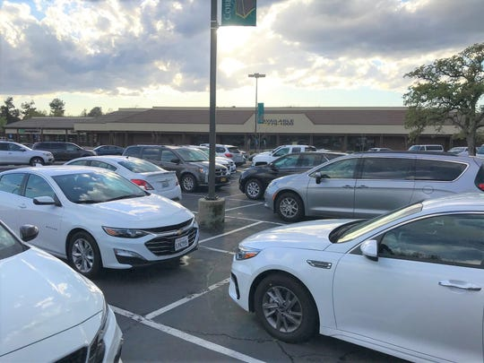 Due to the coronavirus pandemic the parking lot has been bustling with vehicles at the former Raley's grocery store on Hartnell Avenue in Redding even though the store has been closed for the past six years.