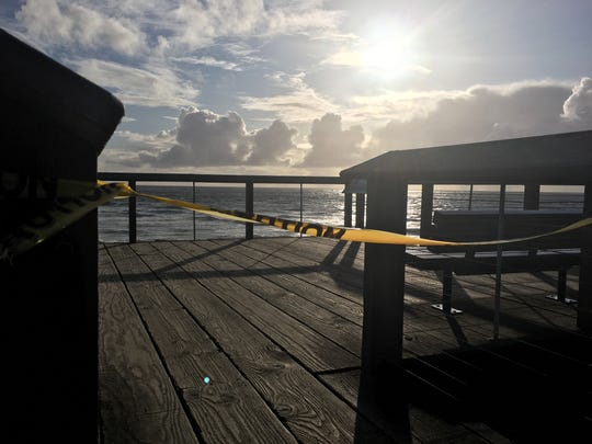 Tape is draped across the entrance to a viewing stand at the Yachats State Park which was closed March 23, 2020.