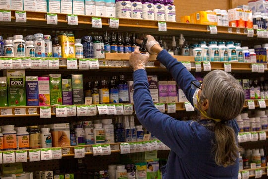 An employee restocks shelves at LifeSource Natural Foods in Salem, on March 23, 2020.