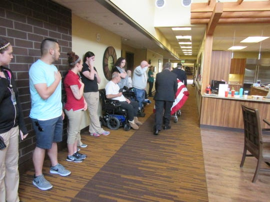 """Staff and residents line the halls in 2016 to participate in the """"Walk of Honor"""" for a deceased veteran escorted from the Lebanon veterans' home."""