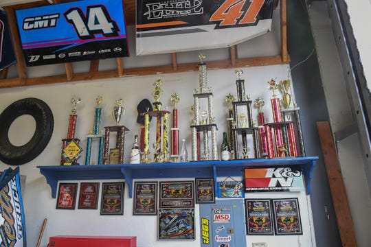 Trophies won by drivers for the Keith Day Racing program, many by Keith Day Jr., line the wall at the entrance of the shop on Madison Lane. March 19, 2020.