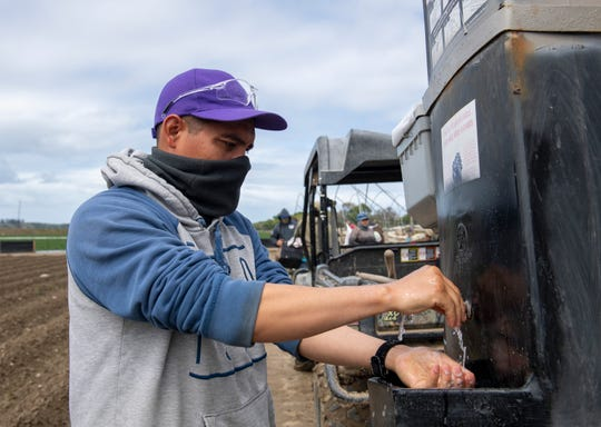 A fieldworker washes his hands as he talks to me about how important it is to wash your hands and wear the right protective gear on March 24, 2020.