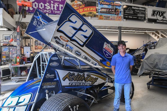 Keith Day Jr. stands next to the sprint car he recently drove to victory at a race in Hanford. March 19, 2020.